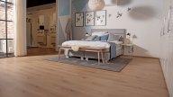 wineo Purline Bioboden Holzoptik Schlafzimmer Showroom