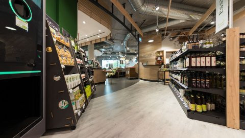 wineo Purline Bioboden Holzoptik Lebensmittel Regale modern Biomarkt