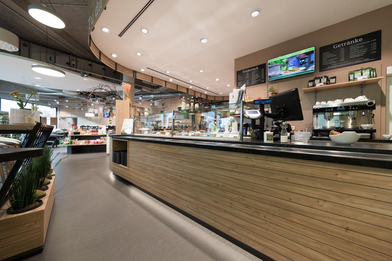 wineo Purline Bioboden Rollenware dunkel warm Holz Lebensmittel Biomarkt